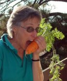 My friend Lynette, enjoying a carrot I grew for her.