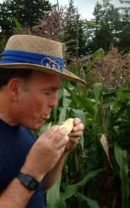 Tom eating corn in garden @Tacoma LAH 4